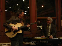 Lynn playing the second guitar he built. Paul Kimball joining him on piano at the Red Newt Bistro.